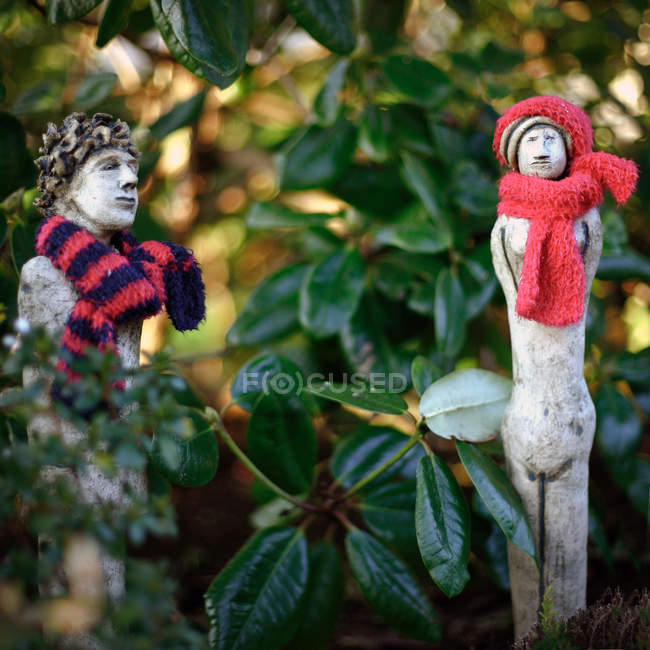 Close Up View Of Garden Figures In Knitted Scarfs U2014 Stock Photo
