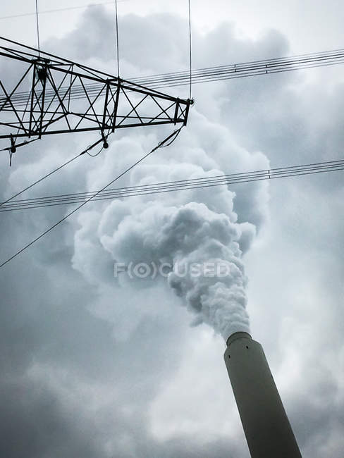 Power lines view and plant pipe — Stock Photo