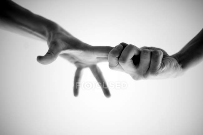 Close-up view of people holding fingers — Stock Photo