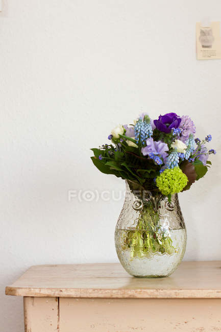 View of floral bouquet in glass vase — Stock Photo