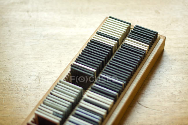 Closeup view of old photographic slides arranged in box — Stock Photo