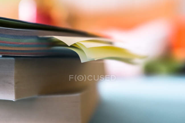 Blurred image of books on table — Stock Photo