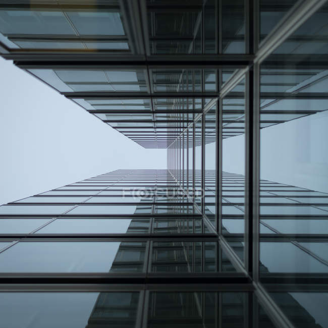Building of modern architecture, glass facade bottom view — Stock Photo