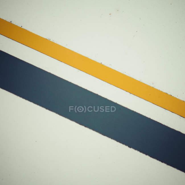 Forme geometriche della struttura, giallo grigio righe — Foto stock