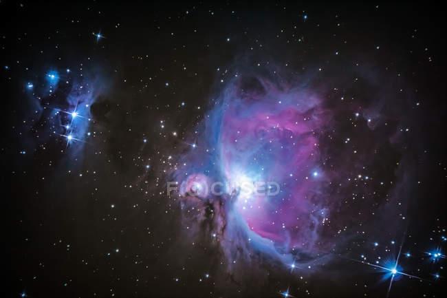 Purple nebula and twinkling stars in night sky — Stock Photo