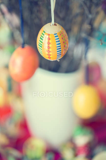 Painted Easter eggs hanging on tree branch — Stock Photo