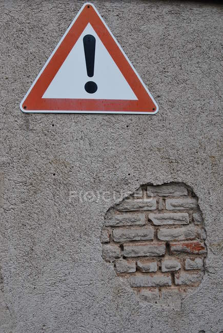 Bricks wall texture and warning sign — Stock Photo
