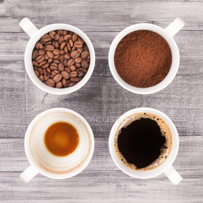 Four coffee stages in cups — Stock Photo