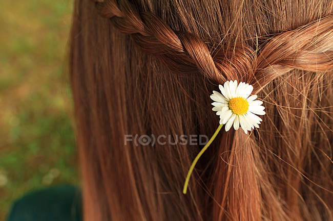 Rear view of red head woman with flower in hair — Stock Photo