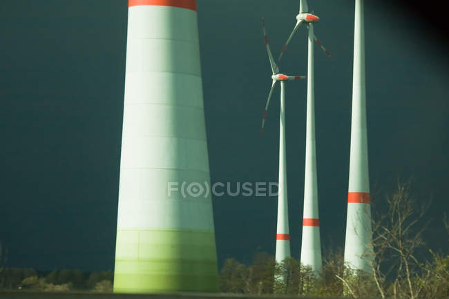 Scene with wind mills park in sunlight, stormy weather — Stock Photo