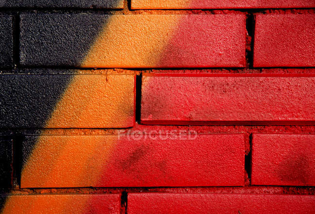 View of red wall painted by graffiti — Stock Photo