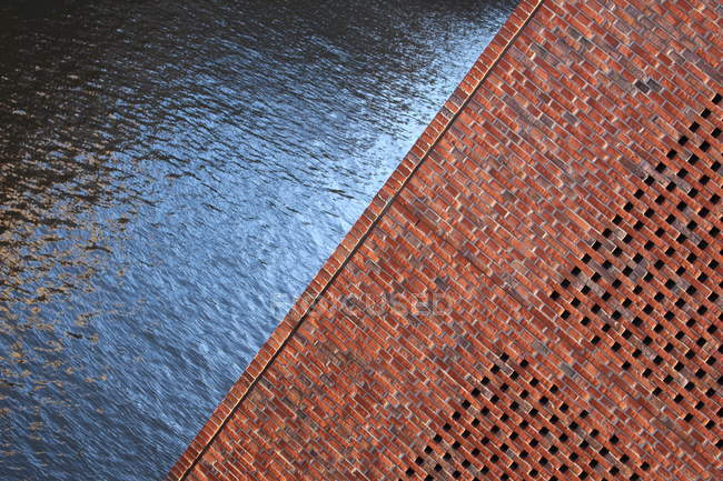 Bricks wall and water surface textures — Stock Photo