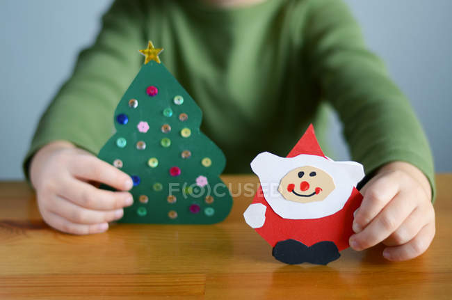 Close-up view of hands holding Christmas cards — Stock Photo