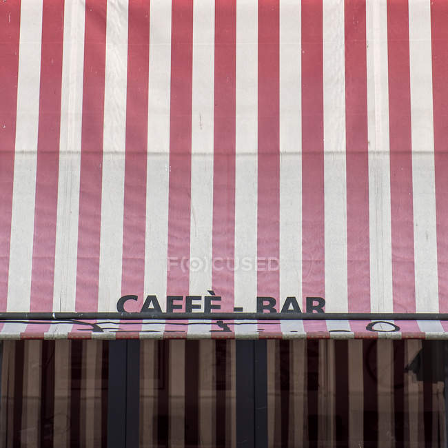 Daytime view of Cafee-bar sign on red and white striped shed — Stock Photo