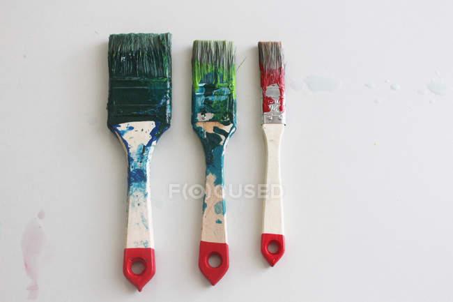 Dirty paint brushes isolated on white background — Stock Photo