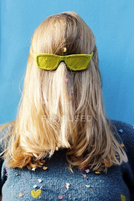 Rear view of woman with painted in yellow glasses on head — Stock Photo