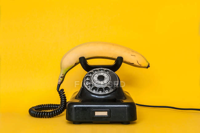 Banana as handset of retro telephone — Stock Photo