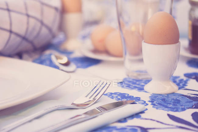 Boiled eggs with crockery — Stock Photo