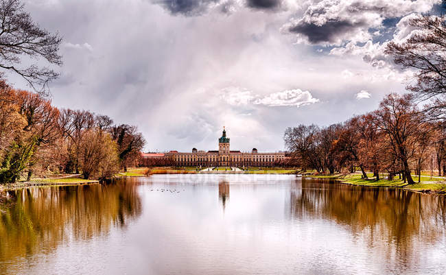 Charlottenburg castle in autumn season, lake with trees on coast — Stock Photo