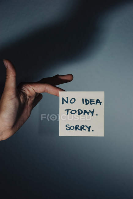 Close-up view of hand touching note — Stock Photo