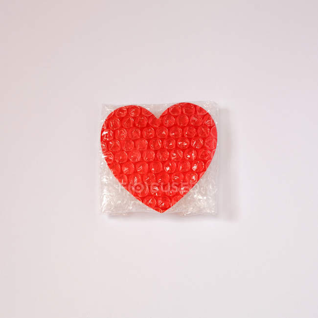 Red hear in bubble wrap — Stock Photo