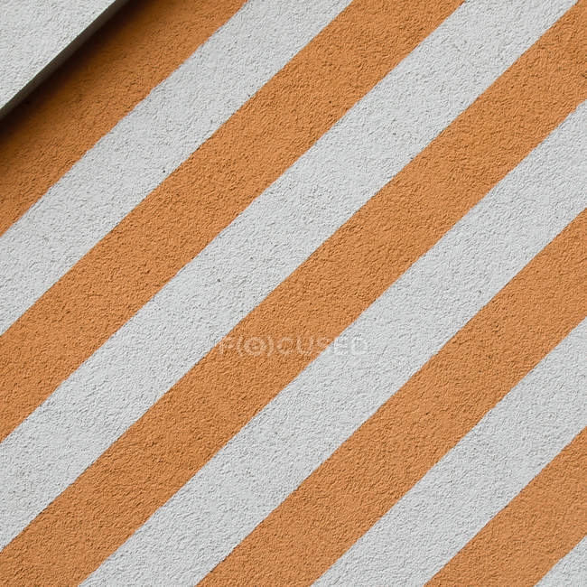 Abstract pattern with striped building wall — Stock Photo