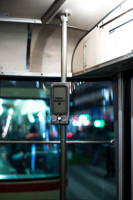 Halte-wunsch sign and button on metal pole in train — Stock Photo