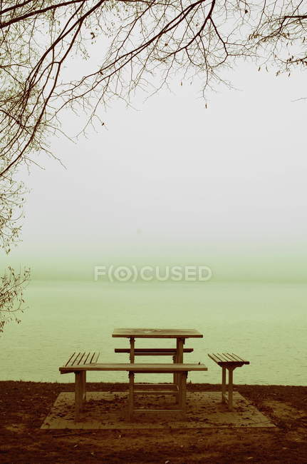 Benches and table by the lakeside — Stock Photo