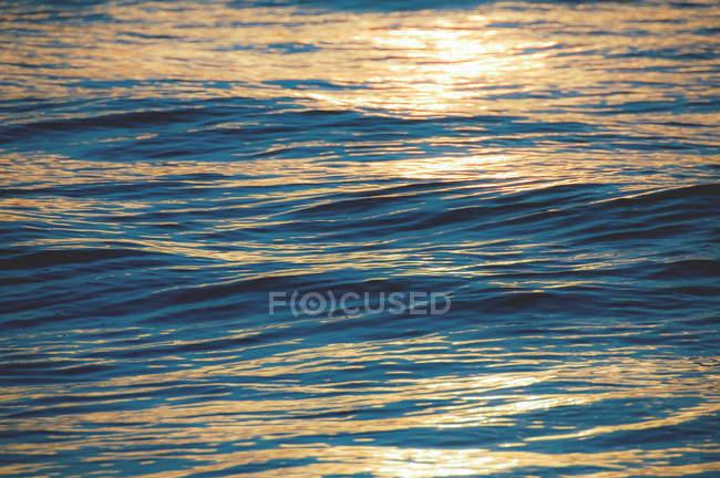 Water surface reflecting sunset light — Stock Photo