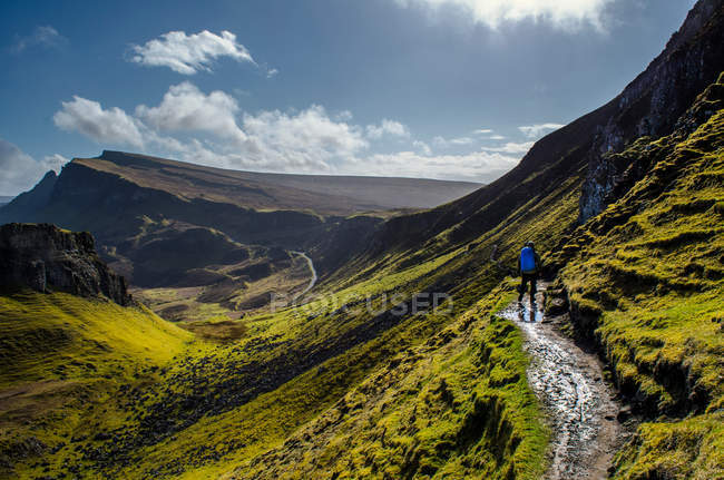Person hiking in summer mountains — Stock Photo