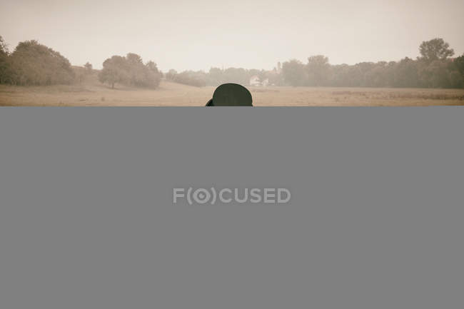 November 4, 2012. Portrait of man sitting at laid table in field — Stock Photo