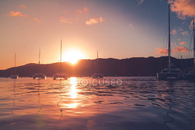 Yachts at sunset time — Stock Photo