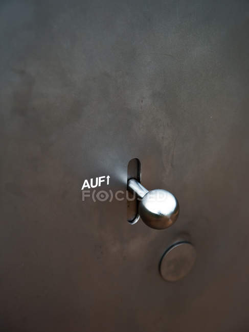 Closeup view of metal switch with AUF marking and arrow upwards — Stock Photo