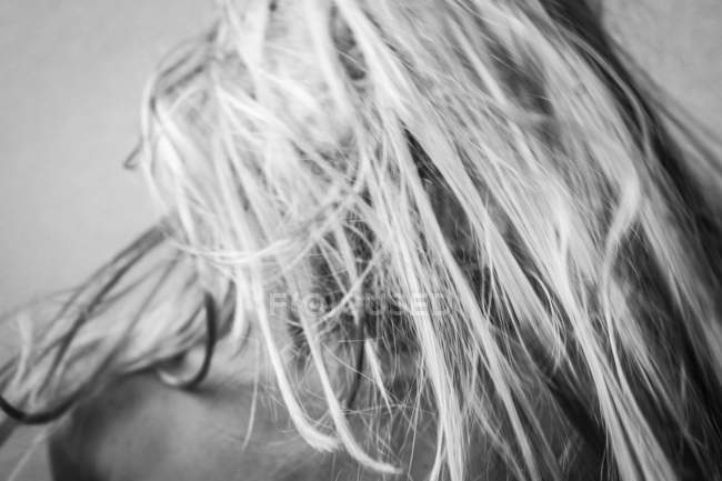 Partial view of woman with blond hair covering face — Stock Photo