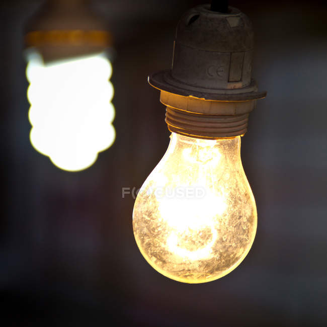 Closeup view of two lit light bulbs — Stock Photo