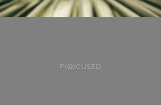 Primer plano de la textura de la tela drapeado - foto de stock