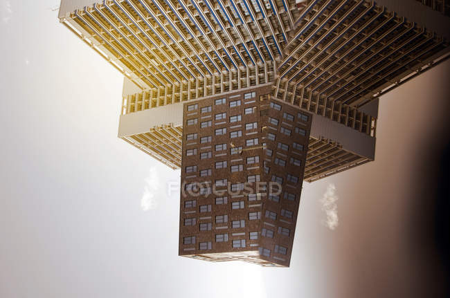 Tilted daytime view of modern buildings and their reflections — Stock Photo