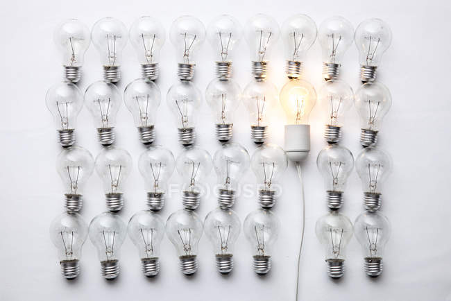 Set of bulbs, one glowing — Stock Photo