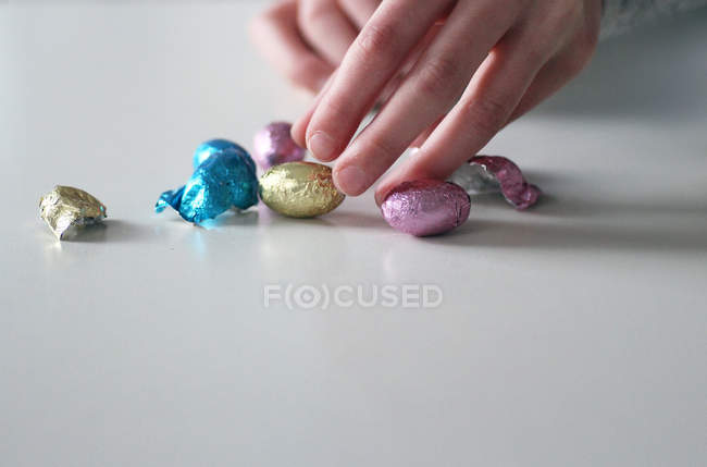 Human hands stretching to candies — Stock Photo
