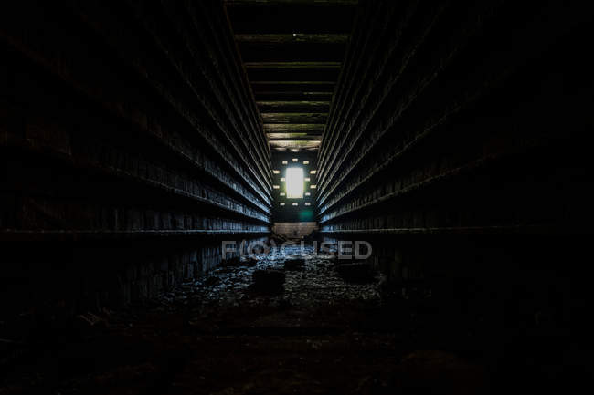 Urban scene, inner dark tunnel view and light at the end — Stock Photo