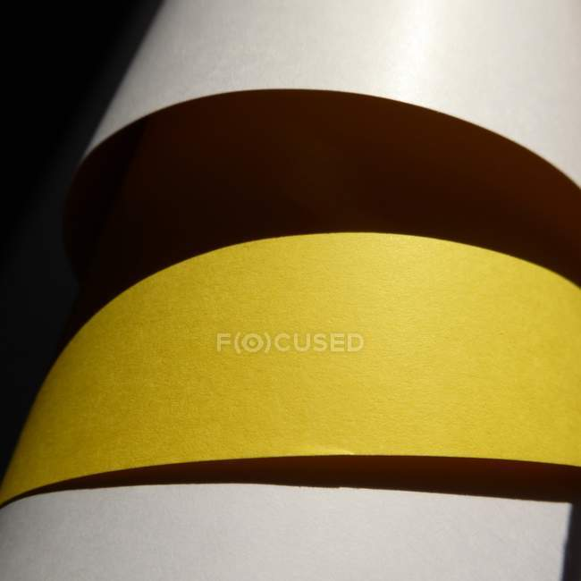 Abstract yellow, brown and white paper shapes surface — Stock Photo