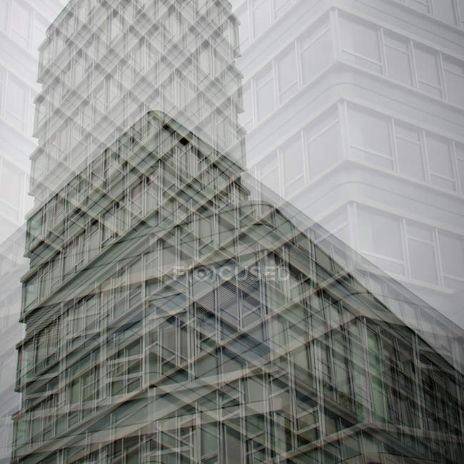 Abstract building walls and windows in double exposure effect — Stock Photo
