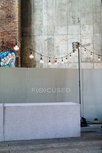 Urban scene with garland of glowing bulbs as decorative element — Stock Photo