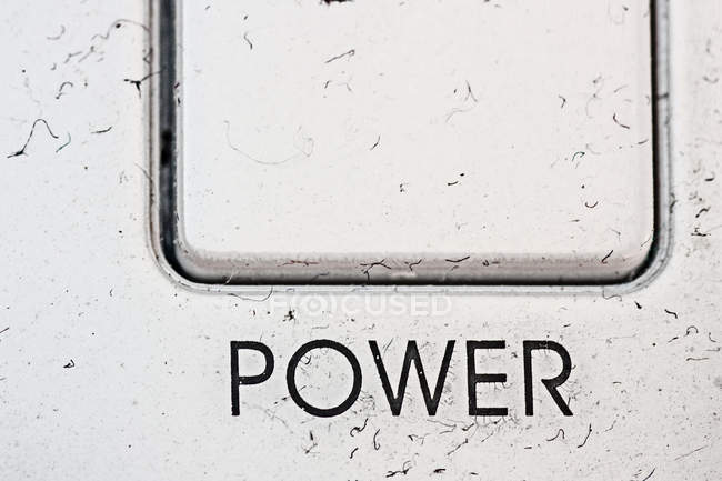 Closeup view of dirty white plastic button with Power word — Stock Photo