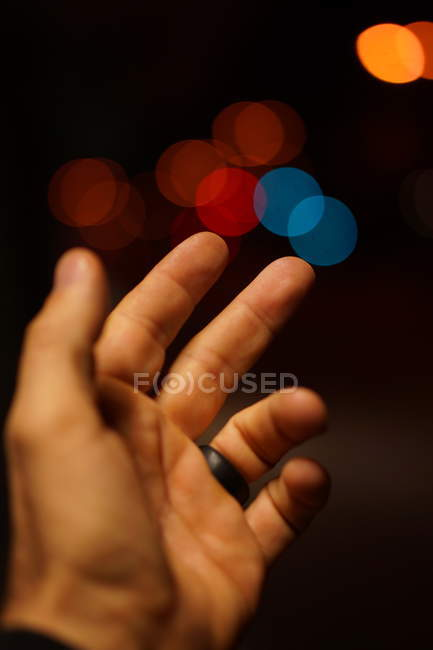 Cropped view of person hand on blurry background — Stock Photo