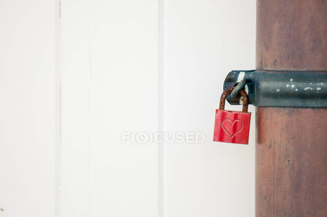 Padlock with heart sign on closed door — Stock Photo