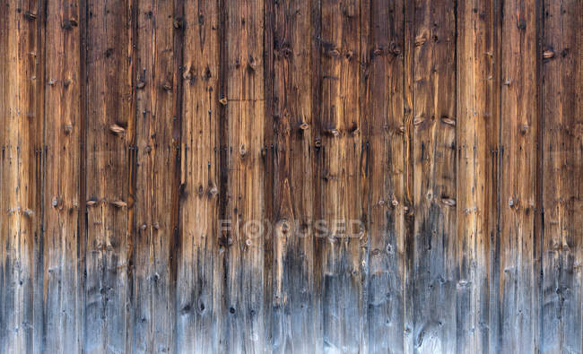 Full frame image of brown wooden wall surface — Stock Photo