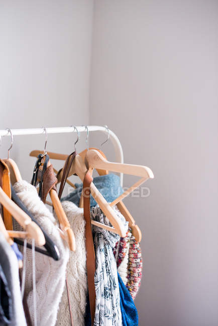 Daytime view of different clothes on hangers — Stock Photo
