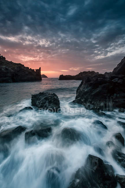 Rocky coastline in sunset light — Stock Photo