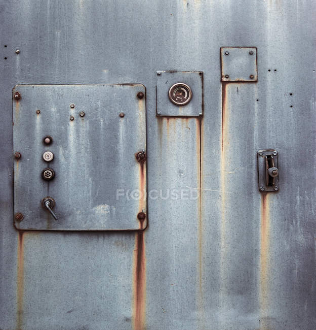 Iron locked door of building — Stock Photo